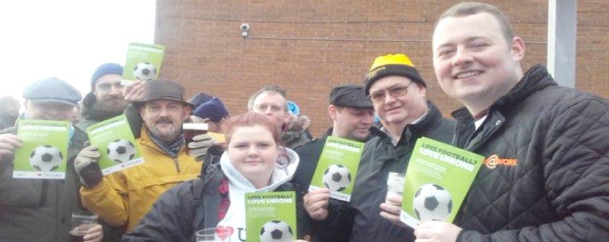 GMB young members at football promoting I LOVE UNIONS